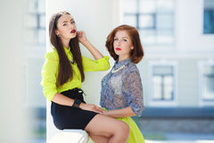 Two young beautiful women on the street in the city. Royalty Free Stock Photos