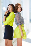 Two young beautiful women on the street in the city. Stock Image
