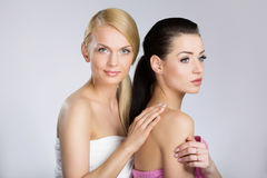 Two young beautiful women in towels stock image