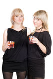 Two young beauty blonde with cocktails. Royalty Free Stock Images