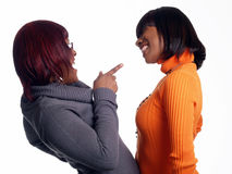 Two young black women in sweaters laughing Stock Image
