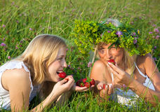 Two Young Blond Women Eating Strawberries Royalty Free Stock Photo