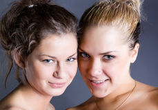 Two young  blonde and  brunette woman Royalty Free Stock Images