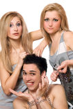 Two young blonde and a guy in chains Stock Photos