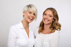 Two blond women smiling. Two young blonde women having fun Stock Images