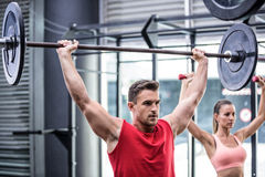 Two young Bodybuilders doing weightlifting Royalty Free Stock Photography