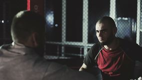 Young boxers preparing for sparring. Two young boxers preparing for sparring, shaking hands in kickboxing gloves stock footage