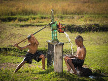 Two young boy rocking groundwater bathe in the hot days. Royalty Free Stock Photo