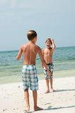 Two young boys on the beach Stock Photography