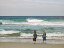 Two young boys at the beach Stock Images