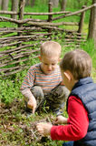 Two young boys discussing lighting a campfire royalty free stock photo
