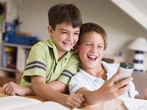 Two Young Boys Distracted From Their Homework royalty free stock images