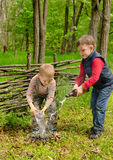 Two young boys extinguishing a small fire stock photo