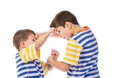 Two young boys fighting stock images