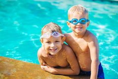 Two Young Boys Having fun at the Pool Royalty Free Stock Image