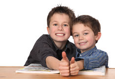 Two young boys learning Royalty Free Stock Photos