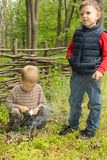 Two young boys learning survival skills Royalty Free Stock Images