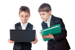 Two young boys looking laptop screen. Portrait of two young boys looking laptop screen, isolated on white background Royalty Free Stock Image