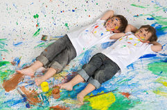 Two young boys lying Stock Photos