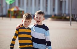 Two young boys outdoors smiling and laugh. Concept friendship.  Stock Images