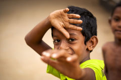 Two young boys play in Sri Lanka Stock Images