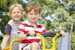 Two Young Boys Playing on Bike Stock Photography