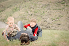 Two young boys playing with their mother Royalty Free Stock Images