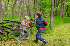 Two Young Boys Playing. In the Woods Stock Photos