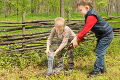 Two young boys putting out a fire Stock Images