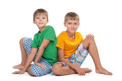 Two young boys sit together Stock Photo