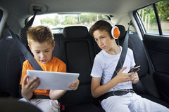 Two young boys sitting in a car Royalty Free Stock Images