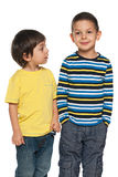 Two young boys are standing together Royalty Free Stock Photography