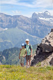 Two young boys in the summer mountains stock images
