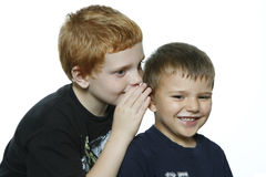 Two young boys telling secrets. Stock Photography
