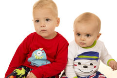 Two young boys wearing winter Christmas pajamas staring Stock Photography