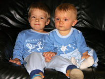 Two young brothers. Sitting on couch Stock Images