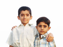 Two Young Brothers. Portrait of two young brothers with their arms around each other, isolated on a white background Stock Photo