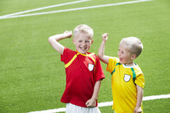 Two young brothers in football field Stock Image
