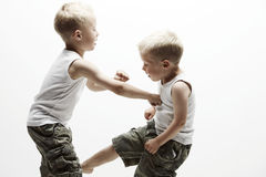 Two young brothers in football field Stock Images