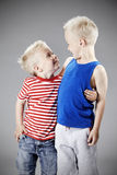 Two young brothers in studio Stock Images