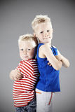 Two young brothers in studio Royalty Free Stock Image