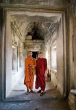 Two young Buddhist priests inside Angkor Wat. Angkor Wat, Cambodia, December 27, 2007. Two young Buddhist priests in a hallway inside the Angkor Wat complex stock photo