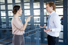 Two young business colleagues having an argument Stock Photos