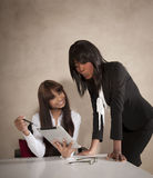 Two young business executives working at desk. With digital tablet Royalty Free Stock Photos