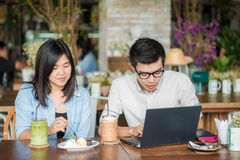 Two young business having a successful co-working at vintage res Royalty Free Stock Photo