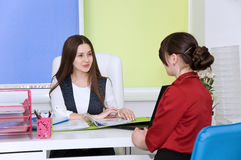 Two young business lady negotiate. Stock Photos