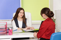 Two young business lady negotiate. Stock Image