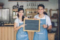 Two young business partner open their cafe Stock Photos