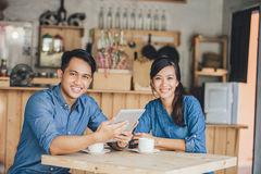 Two young business partner using tablet together. Portrait of two young business partner using tablet together in the cafe Stock Images