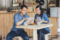Two young business partner using tablet together. Portrait of two young business partner using tablet together in the cafe Stock Image